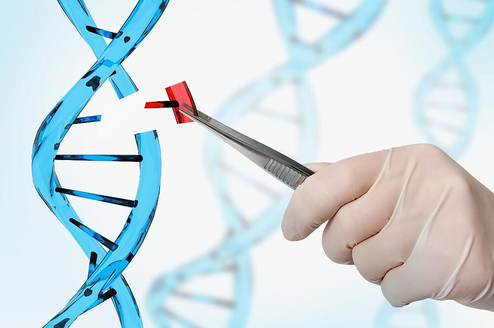 Image of a hand pulling a piece from a DNA strand Adobe stock